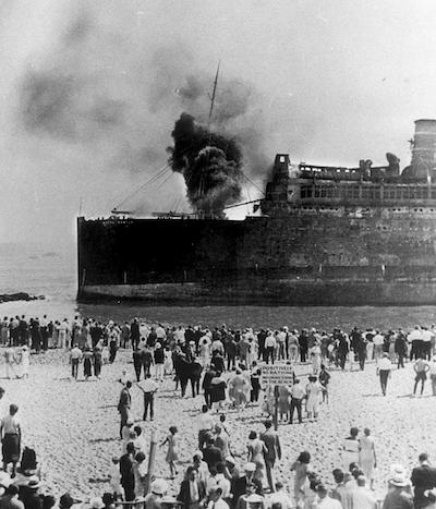 The Morro Castle smoldering by the shore