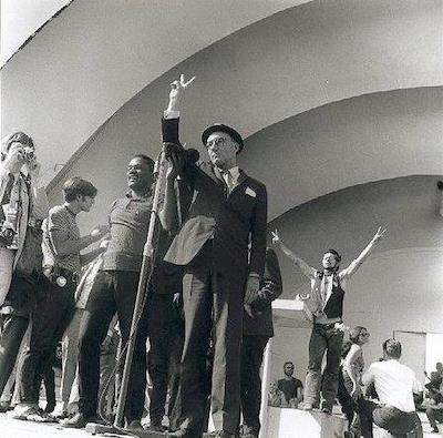 William Burroughs flashing the peace sign in Grant Park, Chicago 1968, photograph by Robert Birnbaum