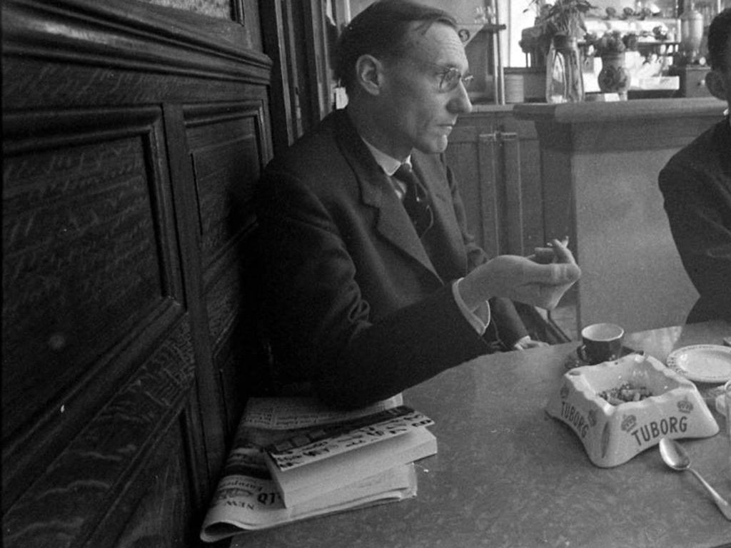 William S. Burroughs with a copy of Naked Lunch at the Beat Hotel, 1959
