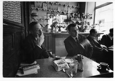 Loomis Dean, William Burroughs and Maurice Girodias in the Beat Hotel cafe, 1959