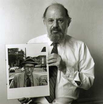 Allen Ginsberg holding his photo of William S. Burroughs
