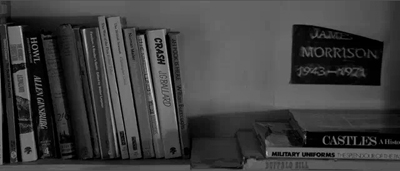 Image from Anton Corbijn's 2007 film Control showing Ian Curtis' bookshelf. Clearly visible are William Burroughs' Naked Lunch and Ah Pook Is Here, as well as books by J.G. Ballard (Crash and The Atrocity Exhibition) and Allen Ginsberg's Howl.