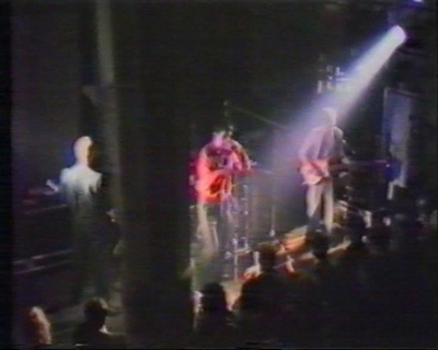 Video still of Joy Division performing at Plan K