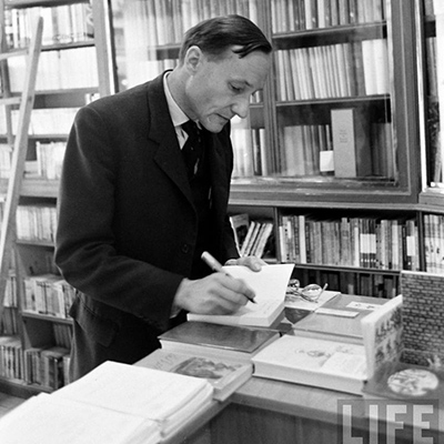 William Burroughs signing Naked Lunch in Left Bank bookstore. Photo by Loomis Dean