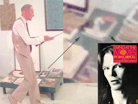 Jim Carroll on the table while William Burroughs demonstrates self-defense techniques