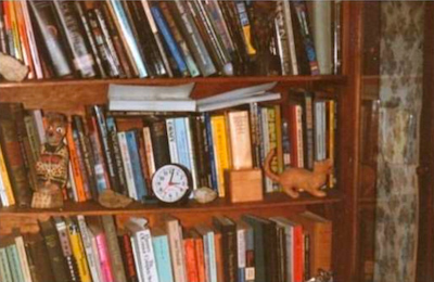 Bookshelf at William Burroughs' home in Lawrence, KS. Photograph by Michael Stevens